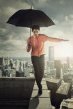 Businessman with umbrella on roof Royalty Free Stock Image