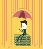 Businessman with umbrella save money. Royalty Free Stock Images