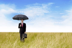 Businessman with umbrella shot outdoor Stock Image