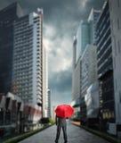 Businessman with an umbrella Stock Photography