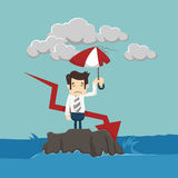 Businessman with umbrella standing in the sea Royalty Free Stock Photo