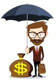 Businessman with umbrella stands and protects a Stock Photos