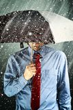 Businessman with umbrella in storm Royalty Free Stock Photo