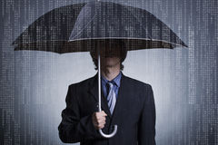 Businessman with an umbrella. Under digital rain Stock Image