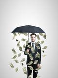 Businessman with umbrella Stock Image