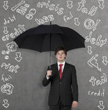 Businessman with umbrella. Young businessman with umbrella and problems rain Royalty Free Stock Image