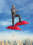 Businessman on umbrellas in the air Royalty Free Stock Photo