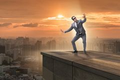 The businessman in uncertainty business concept. Businessman in uncertainty business concept Royalty Free Stock Image