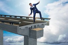 The businessman in uncertainty concept with broken bridge Stock Photography