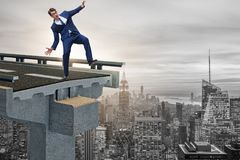 The businessman in uncertainty concept with broken bridge Royalty Free Stock Images