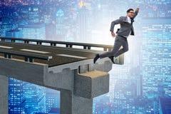 The businessman in uncertainty concept with broken bridge Stock Photography