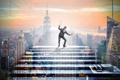 The businessman in uncertainty concept on career ladder Stock Photos