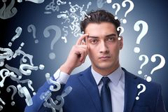 Businessman in uncertainty concept with many unanswered question. S Stock Photo