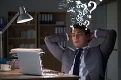 Businessman in uncertainty concept with many unanswered question. S Stock Photos