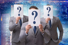 The businessman in uncertainty concept with question marks Stock Photo