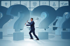 The businessman in uncertainty concept with question marks Royalty Free Stock Images