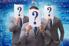 The businessman in uncertainty concept with question marks. Businessman in uncertainty concept with question marks Royalty Free Stock Photos