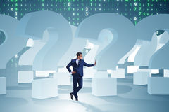 The businessman in uncertainty concept with question marks. Businessman in uncertainty concept with question marks Stock Photography