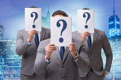 The businessman in uncertainty concept with question marks. Businessman in uncertainty concept with question marks Royalty Free Stock Photography