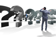 The businessman in uncertainty concept with question marks. Businessman in uncertainty concept with question marks Stock Images