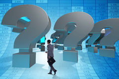 The businessman in uncertainty concept with question marks. Businessman in uncertainty concept with question marks Stock Image