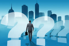 The businessman in uncertainty concept with question marks. Businessman in uncertainty concept with question marks Stock Photos