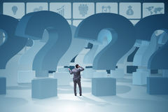 The businessman in uncertainty concept with question marks. Businessman in uncertainty concept with question marks Stock Photo