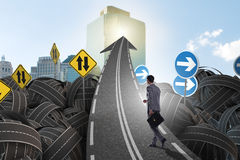Businessman in uncertainty concept on road intersection crossroa Royalty Free Stock Photo