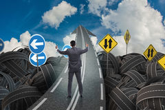 Businessman in uncertainty concept on road intersection crossroa Royalty Free Stock Photography