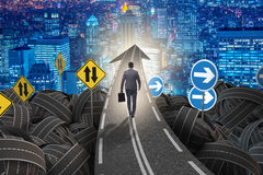 Businessman in uncertainty concept on road intersection crossroa Stock Images
