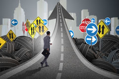 Businessman in uncertainty concept on road intersection crossroa. Ds Royalty Free Stock Images