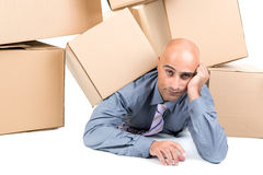 Businessman under boxes Royalty Free Stock Image