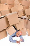 Businessman under boxes Stock Photography
