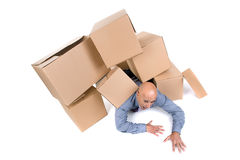 Businessman under boxes Stock Photos