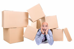 Businessman under boxes Stock Photo