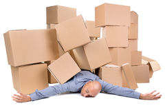 Businessman under boxes Royalty Free Stock Photo