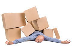 Businessman under boxes Stock Images