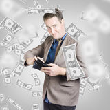 Businessman under falling money. Financial success Royalty Free Stock Photos