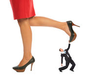 Businessman under Female legs collage Stock Images