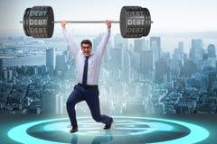 The businessman under heavy burden of debt Royalty Free Stock Photos