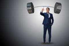 The businessman under  heavy burden of taxes Royalty Free Stock Images