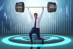 The businessman under  heavy burden of taxes Stock Image