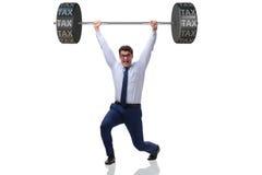 The businessman under  heavy burden of taxes Stock Photo
