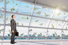 Businessman under money rain Royalty Free Stock Photography