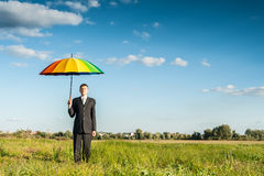 Businessman under protection Stock Images