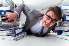 The businessman under stress due to excessive work Stock Image