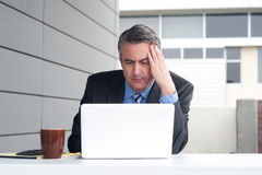 Businessman under stress, fatigue and headache Stock Image