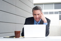 Businessman under stress, fatigue and headache Stock Photos
