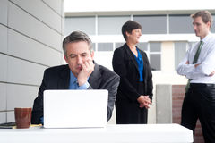 Businessman under stress, fatigue and headache. At the office Royalty Free Stock Photo