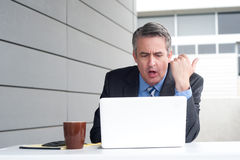 Businessman under stress, fatigue and headache Royalty Free Stock Image